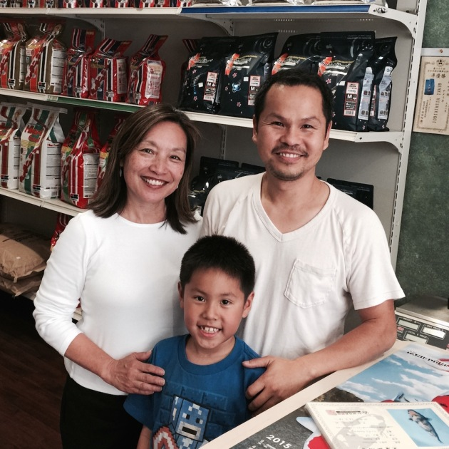 Kevin Pham and his smiling young assistant at Genki Nishikigoi