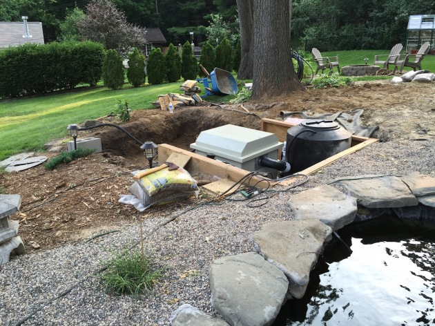 The upper pond's equipment pit seems to have grown larger. The up side is that there should be a pretty large deck or pergola going up over this pit.