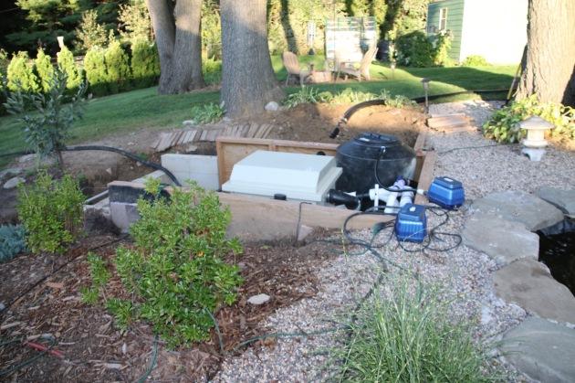 the upper pond's filtration equipment pit - still an eyesore