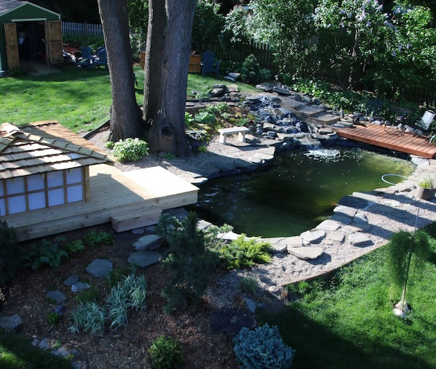 The upper pond from the rooftop this past Saturday.  Still need to finish placing rocks and planting evergreens around the waterfall.