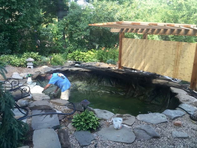 Lots of scrubbing by hand - the pond digger works very hard to keep our ponds nice.